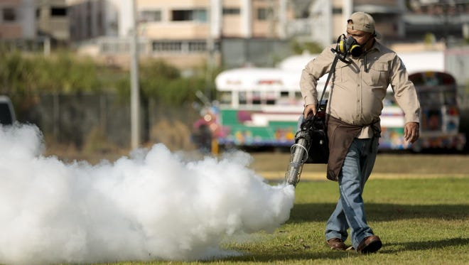 A worker fumigates for Zika virus-carrying mosquitoes in Panama City on Feb. 2, 2016.
