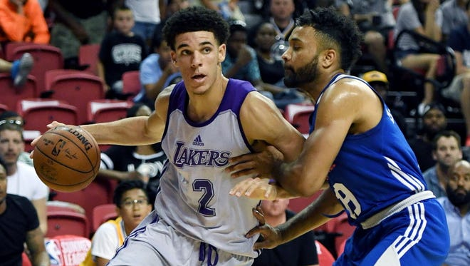Lakers guard Lonzo Ball drives to the basket against 76ers guard James Blackmon Jr. during their summer league game at the Thomas & Mack Center in Las Vegas.