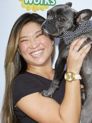 """""""Glee"""" cast member Jenna Ushkowitz shows off her dog Bear at the video premiere."""