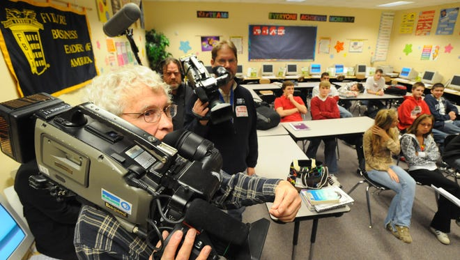 A Wisconsin Public Television crew films a financial literacy class at Fond du Lac High School in March 2009