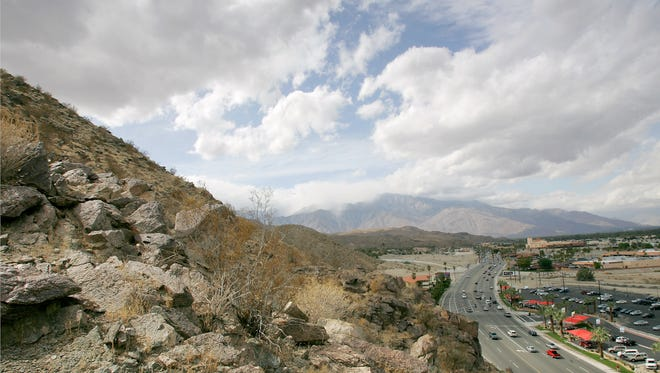 Dark cloud cover rolls through the Coachella Valley as seen from this vantage point at the Cathedral City and Rancho Mirage border above Hwy 111 .