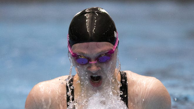 Yorktown's Emily Weiss swims the 100 breaststroke Saturday at the IHSAA girls swimming state championships at IUPUI Natatorium in Indianapolis. Weiss won the race in 1:02.20.