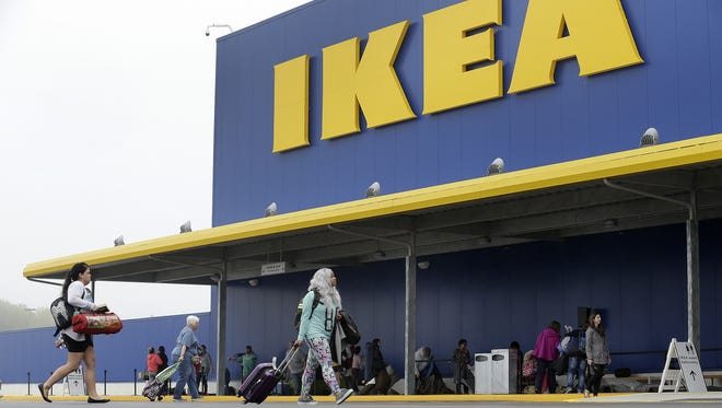 People prepare to camp out before the grand opening of the IKEA  store in Fishers, Ind., in October 2017.