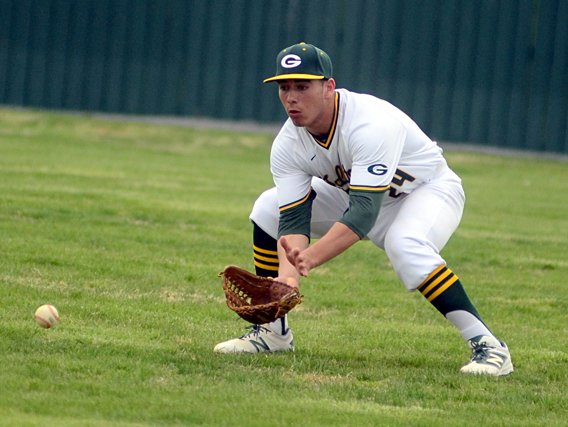Gallatin High senior Carlos Hernandez fields a ball in rightfield during fourth-inning action.