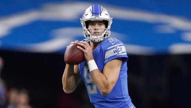 Detroit Lions quarterback Matthew Stafford (9) looks for an open man during the first quarter against the Pittsburgh Steelers at Ford Field.