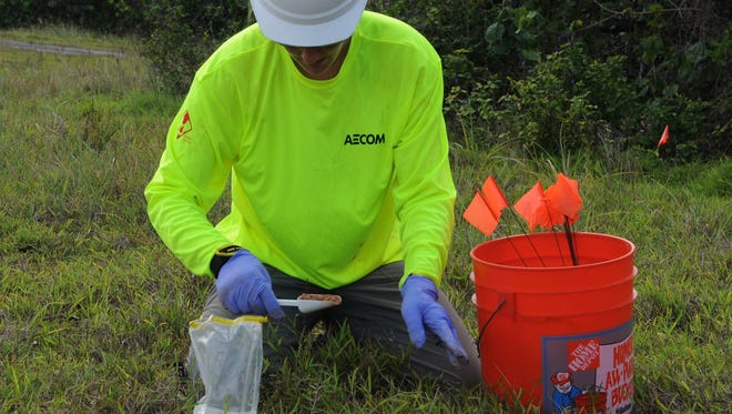 In this file photo, soil samples are collected for Agent Orange analysis. Vice Speaker Therese Terlaje said the U.S. Government Accountability Office can't find some shipping records related to Agent Orange distribution.