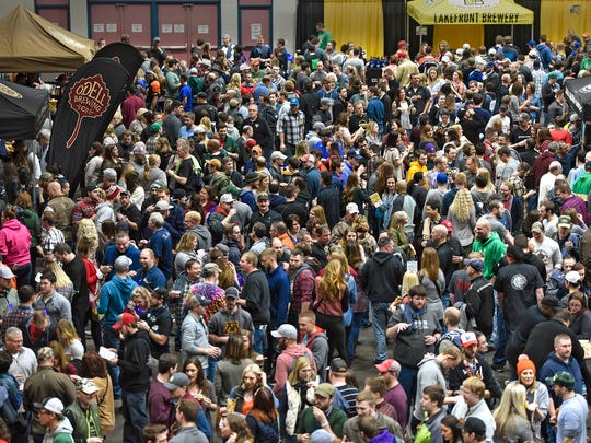 Participants make their way past brewery booths during the 2017 St. Cloud Craft Beer tour at the River's Edge Convention Center in St. Cloud.