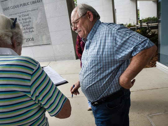 Ed Schmidt gathers signatures on a petition to put