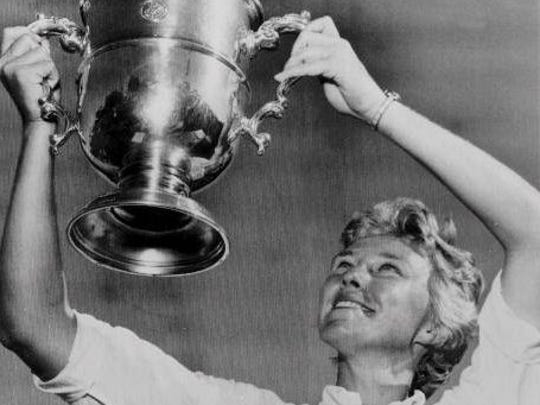 Mickey Wright raises her fourth U.S. Open Women's Golf Championship trophy in this file photo from 1964. Wright won 13 major championships and 82 pro tour events. She died Monday at 85 years old.