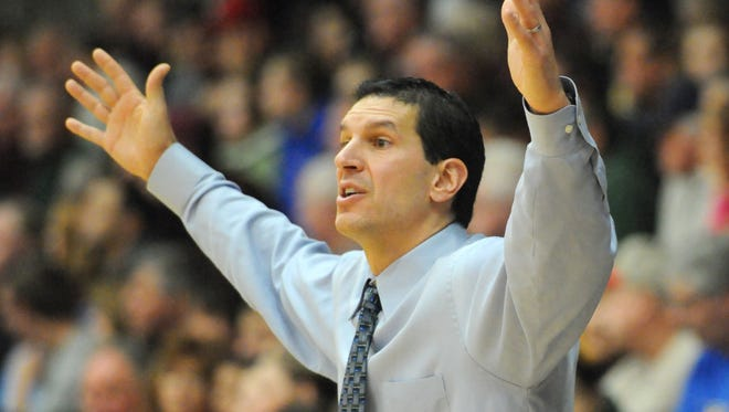 St. Norbert College men's basketball coach Gary Grzesk