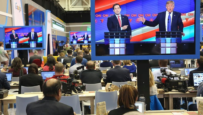 Republican Presidential Candidates Marco Rubio and  Donald Trump are seen on television in the CNN filing room during the Republican Presidential Debate at the University of Houston in Houston, Texas on Feb. 25, 2016.