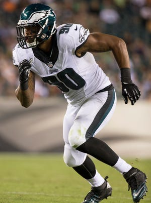 Philadelphia Eagles' Marcus Smith II in action during the first half of an NFL preseason football game against the New York Jets, Thursday, Aug. 28, 2014, in Philadelphia. The Eagles won 37-7. (AP Photo/Chris Szagola)