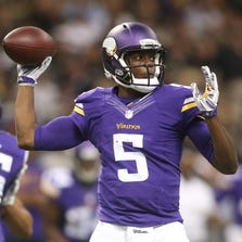 Sep 21, 2014; New Orleans, LA, USA; Minnesota Vikings quarterback Teddy Bridgewater (5) looks to pass the ball against the New Orleans Saints in the first half at Mercedes-Benz Superdome.