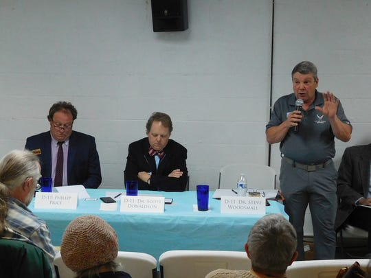 Congressional candidate Steve Woodsmall speaks at a recent debate in Asheville.