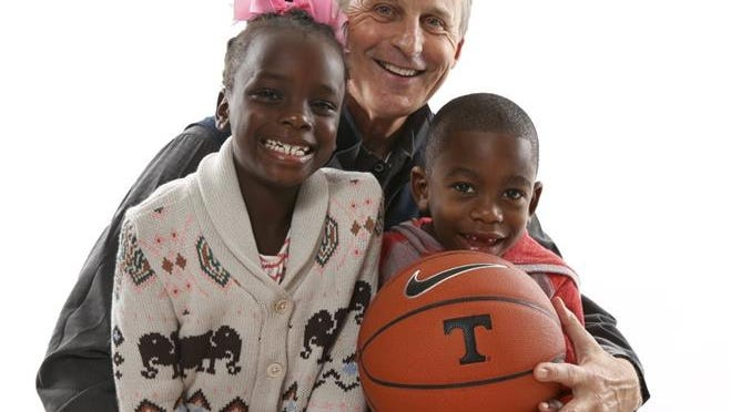 Tennessee men's basketball coach Rick Barnes is pictured with his grandchildren Avery and Caleb.