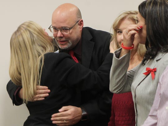 Dan Mockbee, husband of murder victim Michelle Mockbee, hugs Boone Commonwealth's Attorney Linda Tally Smith after Dooley's conviction in 2014.