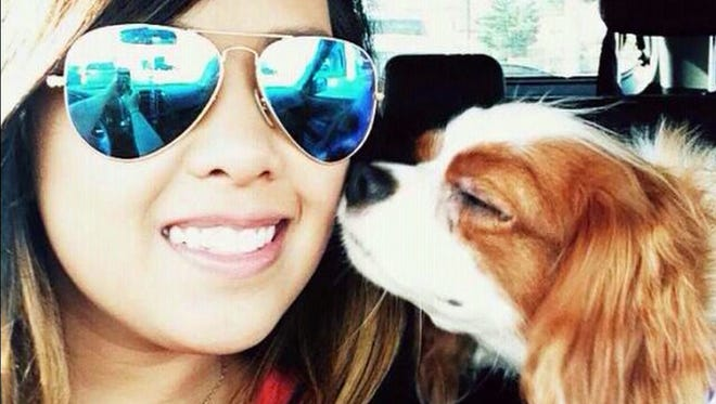 Nurse Nina Pham, 26, of Dallas with her Cavalier King Charles spaniel named Bentley.