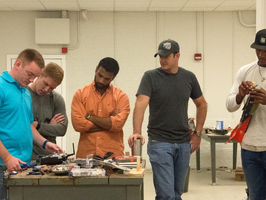 From left aerospace engineering students Philip Cutler,