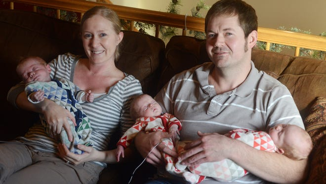 Nicole and Brad Holmberg with their triplets, William, Cecelia and Grace who were born in October, Dec 23, 2015.