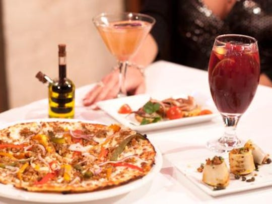 The menu at Alicante offers Spanish Mediterranean choices, including pizza and tapas.
