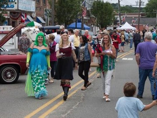 Just an ordinary day, with mermaids walking down the street.