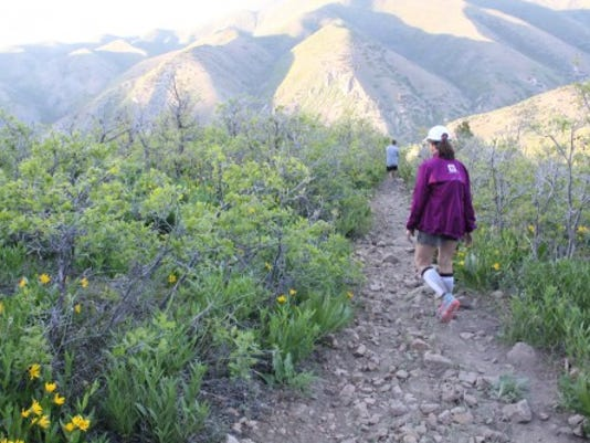 Karen Mitchell of Manchester Township recently completed the Squaw Peak 50-mile Trail Run in Provo, Utah, which took competitors through rough terrain in the Wasatch Mountains. Here, she navigates rocky terrain in the last nine miles of the race.  (submitted)