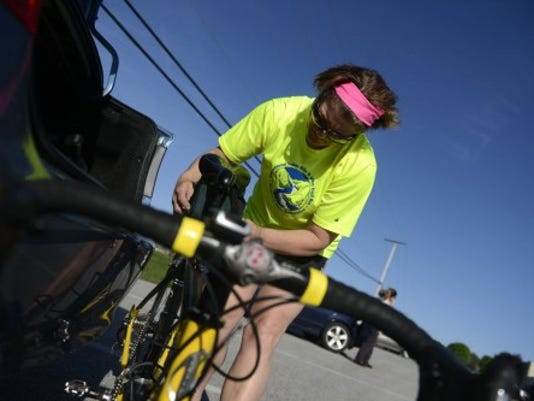 Jen Roberts of Hanover gets her bike ready to ride at the YMCA in Hanover. Roberts rides with the Hanover Cyclers (photo by Kate Penn)