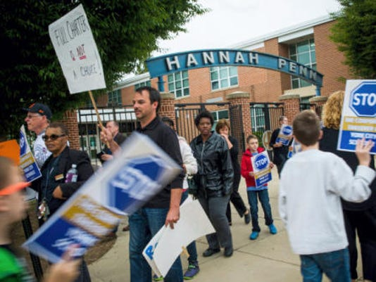 Community members rallied before a recent meeting about charter schools last night.