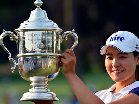 South Korea's In Gee Chun holds up the championship trophy after winning the U.S. Women's Open at Lancaster Country Club on Sunday.
