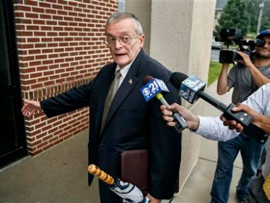 Former Harrisburg Mayor Stephen Reed arrives outside court for his preliminary arraignment at District Judge William Wenner's offices in Lower Paxton Township on Tuesday.