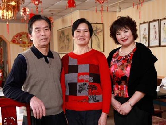 Qiu qi Li and Mei zhen Dong, owners of the Golden Palace restaurant in Newark, got needed health screenings after encouragement from Xiangfen Gu, right, who is taking cancer prevention and health screening information into Delaware's Chinese community.