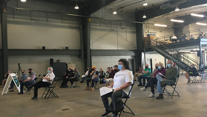 More than 100 voters gathered Saturday, Nov. 7 at the town's highway garage where they approved $13.9 million in water projects as well as spending $630,000 to purchase several trucks for the Department of Public Works.