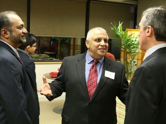 Jamil Tourk (center) with Dr. Muqtedar Khan (left) and Rep. John Carney.
