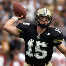 Former Purdue QB Drew Brees gets the nod over Michigan's Tom Brady in Big Ten's Ultimate NFL lineup.