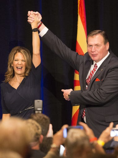 Former U.S. Rep. J.D. Hayworth, R-Ariz., (right) holds up Dr. Kelli Ward's hand during a Kelli Ward for senate campaign kickoff event at the Hilton Scottsdale Resort  October 17, 2017.