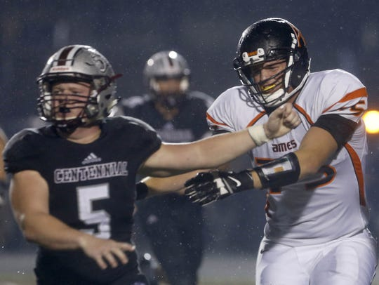 Ames offensive lineman Colin Newell (75) pushes Ankeny
