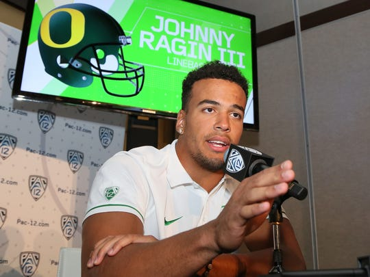 Oregon linebacker Johnny Ragin III speaks at the Pac-12 NCAA college football media day in Los Angeles Thursday, July 14, 2016.