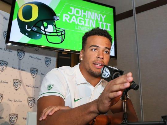 Oregon linebacker Johnny Ragin III speaks at the Pac-12