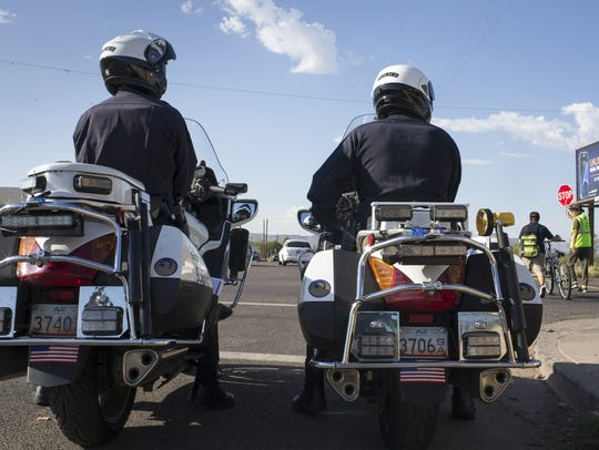 Two Phoenix officers monitor traffic on August 8, 2016, in a school safety zone in Phoenix.