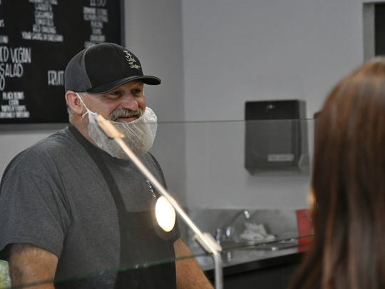 The Salad Shop co-owner John Lawson talks with customers