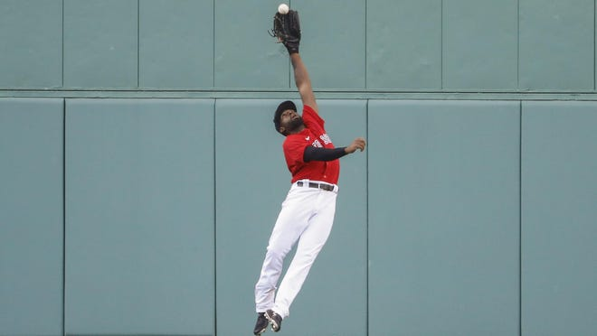 Red Sox center fielder Jackie Bradley Jr. makes a leaping catch on a ball hit by the  Blue Jays' Rowdy Tellez during the sixth inning of the first game of Friday's doubleheader at Fenway Park.