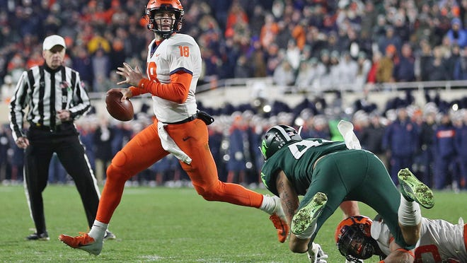 Illinois quarterback Brandon Peters (18) scrambles before throwing the game winning touchdown in the fourth quarter of their Big Ten football game against Michigan State at Spartan Stadium in East Lansing, on Saturday, November 9, 2019. Illinois won the game, 37-34.