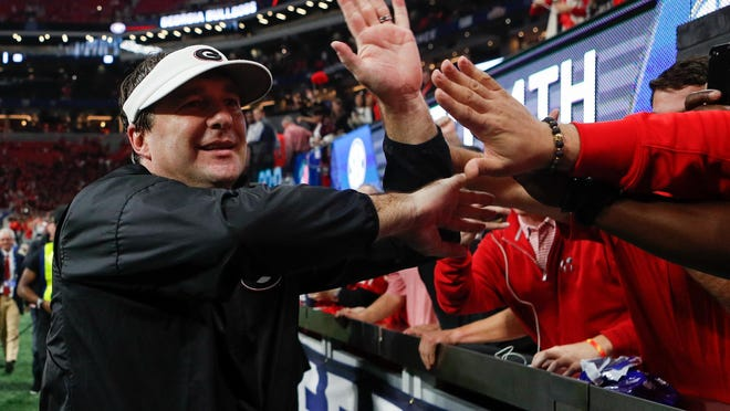 Georgia head coach Kirby Smart high fives fans after the 2017 SEC Championship victory over Auburn. With Georgia recruiting at a high level, now is the time for it all to pay off.