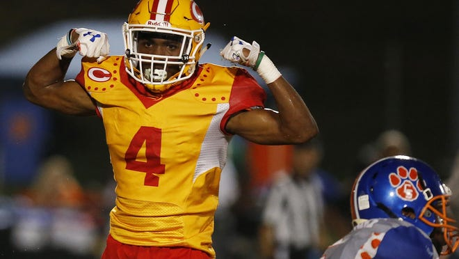 Clarke Central's Kapres Forbes (4) celebrates after stoping a kick return inside the 20 yard line during a GHSA high school football game between Clarke Central and Cedar Shoals in Athens, Ga., on Friday, Sept. 22, 2017.