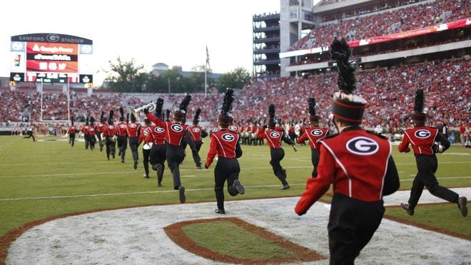 The Redcoat band takes the field just before the start of a NCAA college football game between Georgia and Samford in Athens, Ga., Saturday, Sept. 16, 2017.
