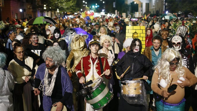 Wild Rumpus participants parade through downtown Athens in October 2017. Wild Rumpus is planning virtual events this year.