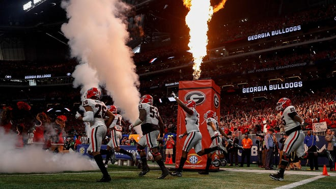 Georgia takes the field before the first half of the SEC Championship football game between Georgia and Auburn on Saturday, Dec. 2, 2017, in Atlanta.