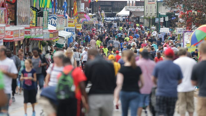 Thousands of people pack Grandstand Ave. at State Fair Park on the opening day of the 2017 Wisconsin State Fair on Aug. 3.