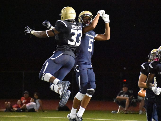 Players celebrate during the Big 33 Classic held at