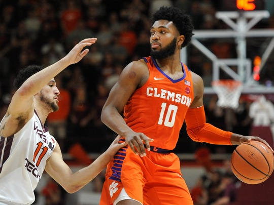 Clemson Tigers guard Gabe DeVoe (10) looks to pass while being defended by Virginia Tech Hokies guard Devin Wilson (11) Wednesday night during the first half at Cassell Coliseum in Blacksburg, Virginia.